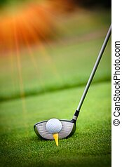 Macro shot of a golf club ready to drive the ball - A golf...