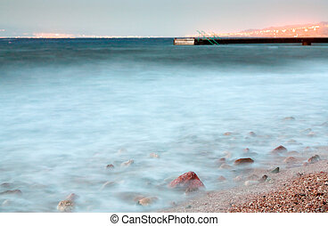 pier in Red Sea at late evening near Aqaba town, Jordan