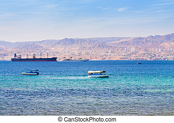 Aqaba gulf and view on Israel town Eilat from Jordan