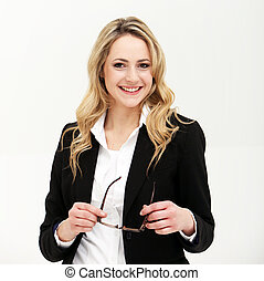Smiling confident busineswoman or manageress holding a pair...