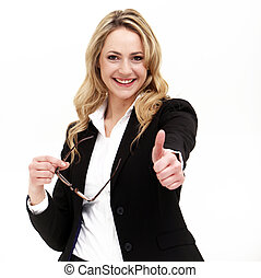 Attractive business woman giving thumbs up