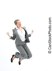 Successful woman jumping for joy with both feet raised and...