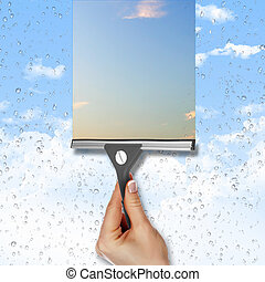Window with blue sky and white clouds