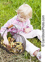 little girl with basket of mushrooms