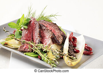 Roast beef   - Slices of roast beef  and vegetable garnish
