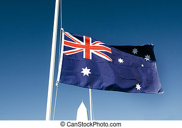 Anzac Day - War Memorial Service - The national flag of...