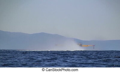 Firefighter airplane rises up from the sea