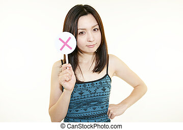 Young woman holding a X mark sign