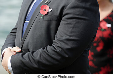 Anzac Day - War Memorial Service - Close up of an ANZAC red...