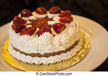 Whipped cream cake with strawberries