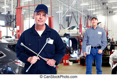 Car mechanic. - Car mechanic with wrench. Auto repair...