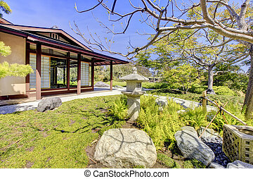 Japanese garden in San Diego with a house structure.