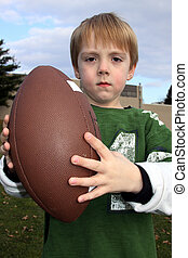 Little boy holding a footbal