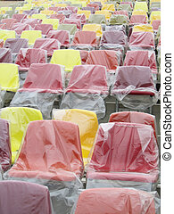 colored seats with a cellophane covering