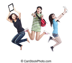 Excited group of girl students jumping - isolated over white...
