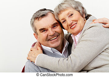 Happy in marriage - Portrait of a mature couple happily...