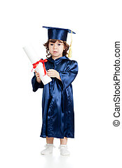 Adorable child in academician clothes with roll