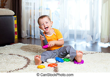 funny child playing with color toy