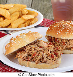 Pulled Pork Sandwich - Pulled pork sandwich on a bun with...