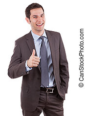 Young caucasian businessman making thumbs up gesture,...