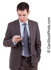 Portrait of a young caucasian business man using a mobile...