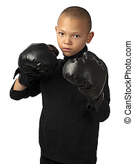Ready to fight - This young boy with black boxing gloves...