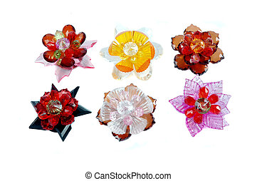 a craft beaded crystal of flower-shaped brooch isolated on...