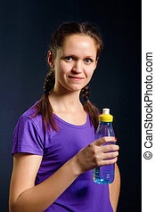 woman with a bottle of water