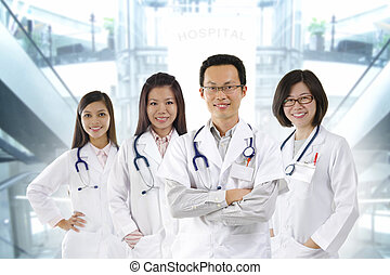 Medical team - Asian medical team standing inside hospital...