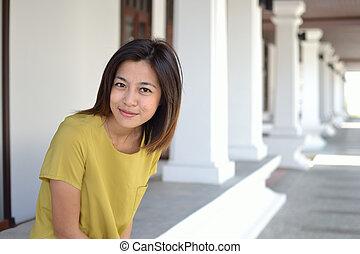 Cute asian woman - Cute young asian woman portrait outdoor...
