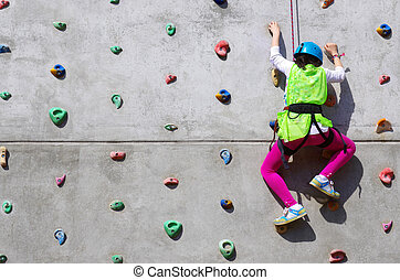 Young Climber - Youngster's effort in climbing a wall to...