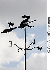 witch weather vane - weather vane showing witch riding a...