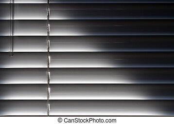 Blinds - Evocative picture of sunlight shining through...
