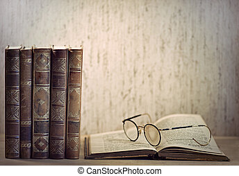 Vintage books and glasses on desk
