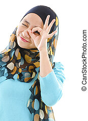 Eye care - Young muslim woman focused by hand hole