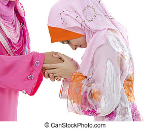 Muslim greeting - Young Muslim women greeting to elders