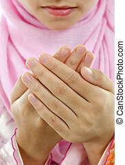 Muslim prayer - Muslim female cupped hand and praying