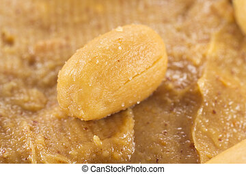 Closeup of a peanut on peanut butter