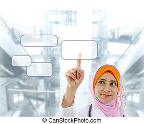 Medical concept - Young Muslim female doctor finger pressing...