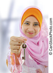 New property - Muslim woman holding a new key