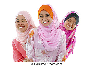 Muslim woman - Happy Muslim women standing in row, on white...