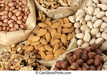 Assorted nuts - Close-up of assorted nuts in paper bags.