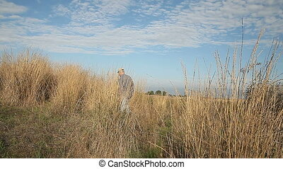 walking away in dry grasses