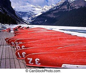 Upturned canoes, Lake Louise. - Upturned canoes on the edge...