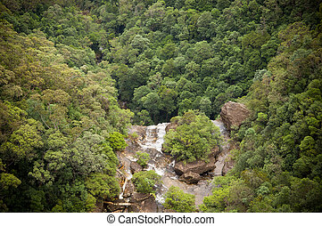 Waterfall Valley - Waterfall flows into valley below with...