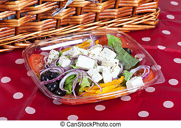 Greek salad with Feta cheese, red onions, olives and yellow...