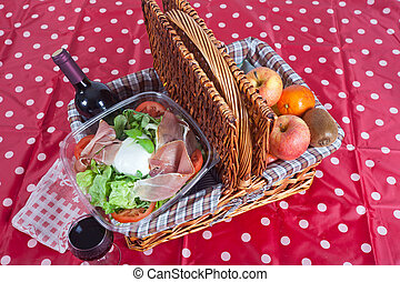 Pic-nic basket with salad and fruits