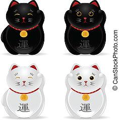 Lucky cats (Maneki Neko) - Japanese sculptures of cats...