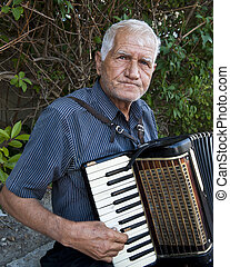 Old Man with Accordian - Old Man with wrinkled face plays...