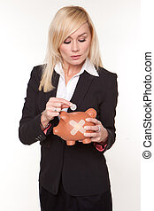 Woman holding piggy bank with a plaster